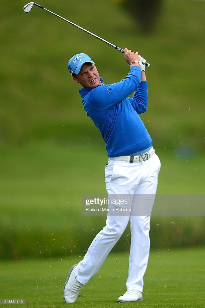 <a gi-track='captionPersonalityLinkClicked' href=/galleries/search?phrase=Danny+Willett&family=editorial&specificpeople=4488861 ng-click='$event.stopPropagation()'>Danny Willett</a> of England hits his 3rd shot on the 9th hole during the first round of the 100th Open de France at Le Golf National on June 30, 2016 in Paris, France.