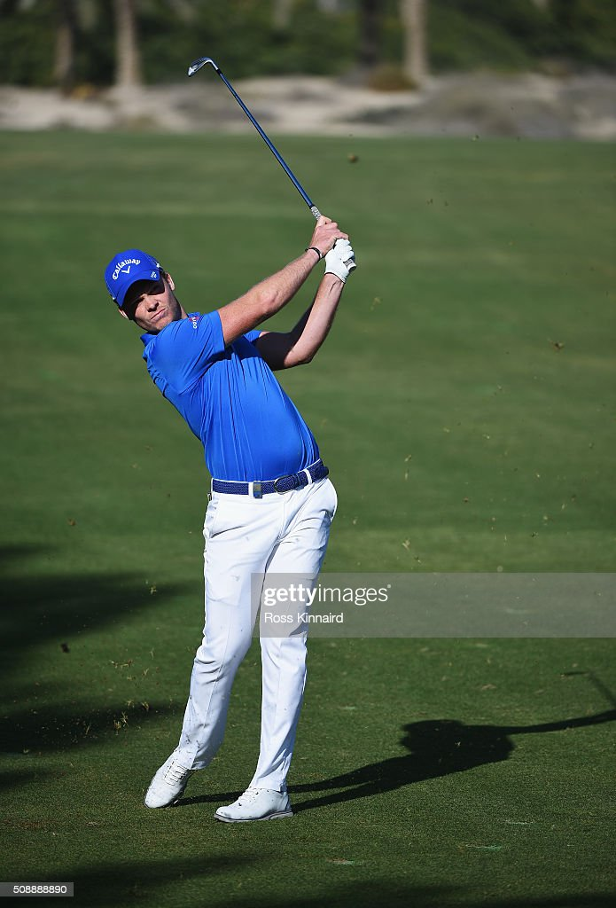 <a gi-track='captionPersonalityLinkClicked' href=/galleries/search?phrase=Danny+Willett&family=editorial&specificpeople=4488861 ng-click='$event.stopPropagation()'>Danny Willett</a> of England hits his second shot on the 14th hole during the final round of the Omega Dubai Desert Classic at the Emirates Golf Club on February 7, 2016 in Dubai, United Arab Emirates.