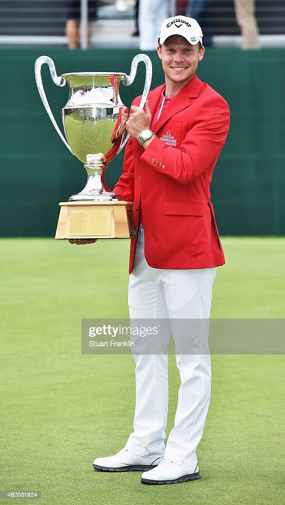 Danny Willett of England holds the trophy after winning the Omega European Masters at CranssurSierre Golf Club on July 26 2015 in CransMontana...