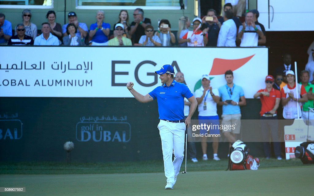Danny Willett of England holes his birdie putt to win the tournament at the par 5 18th hole during the final round of the 2016 Omega Dubai Desert...