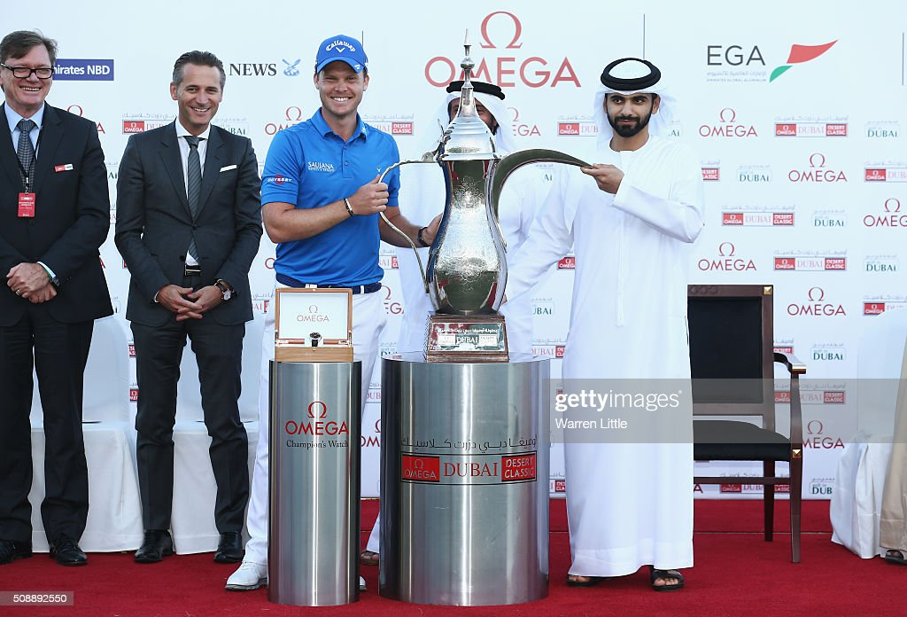 <a gi-track='captionPersonalityLinkClicked' href=/galleries/search?phrase=Danny+Willett&family=editorial&specificpeople=4488861 ng-click='$event.stopPropagation()'>Danny Willett</a> of England is presented with the trophy by Sheikh Mansoor bin Mohammed bin Rashid al-Maktoum after the final round of the Omega Dubai Desert Classic at the Emirates Golf Club on February 7, 2016 in Dubai, United Arab Emirates.