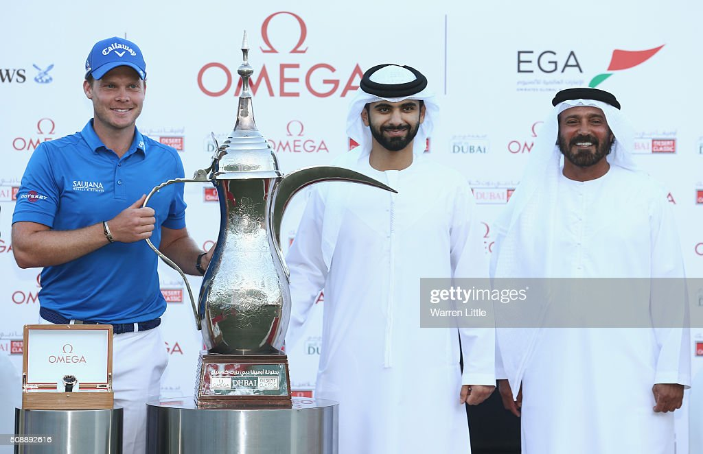 <a gi-track='captionPersonalityLinkClicked' href=/galleries/search?phrase=Danny+Willett&family=editorial&specificpeople=4488861 ng-click='$event.stopPropagation()'>Danny Willett</a> of England is presented with the trophy by Sheikh Mansoor bin Mohammed bin Rashid al-Maktoum (C) after the final round of the Omega Dubai Desert Classic at the Emirates Golf Club on February 7, 2016 in Dubai, United Arab Emirates.