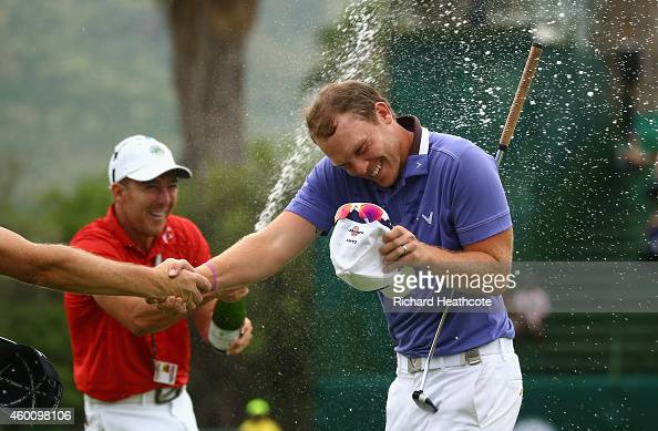 Danny Willett of England is sprayed with champagne as he celebrates victory during the final round of the Nedbank Golf Challenge at the Gary Player...