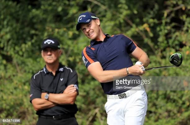 Danny Willett of England is watched by coach Pete Cowen during a practice round prior to The Honda Classic at PGA National Resort Spa Champions...