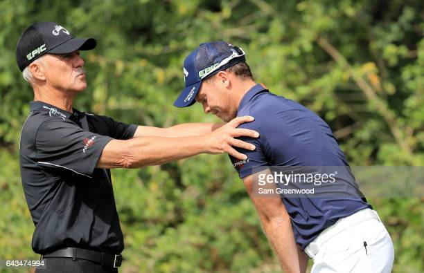 Danny Willett of England is works with coach Pete Cowen during a practice round prior to The Honda Classic at PGA National Resort Spa Champions...