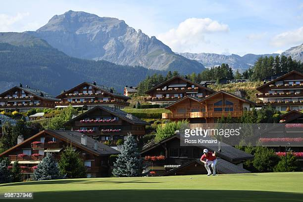 Danny Willett of England lines up a putt on the 14th green during the second round of the Omega European Masters at CranssurSierre Golf Club on...