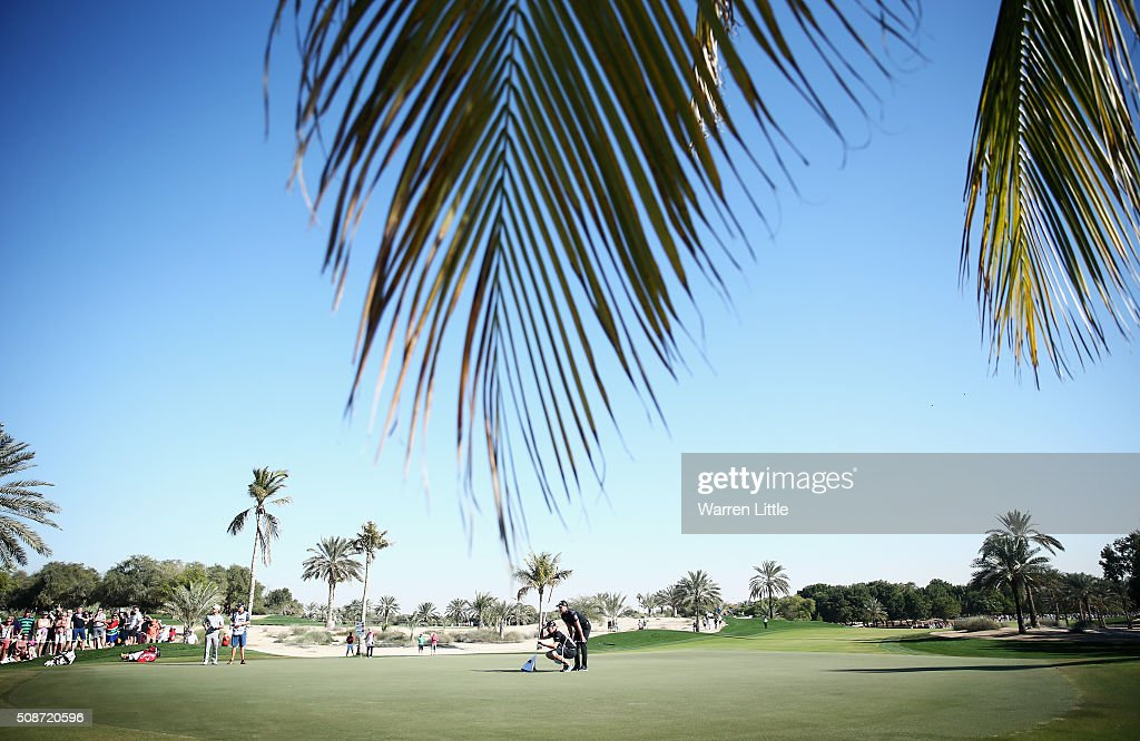 <a gi-track='captionPersonalityLinkClicked' href=/galleries/search?phrase=Danny+Willett&family=editorial&specificpeople=4488861 ng-click='$event.stopPropagation()'>Danny Willett</a> of England lines up a putt with his caddie Jonathan Smart on the 12th green during the third round of the Omega Dubai Desert Classic at the Emirates Golf Club on February 6, 2016 in Dubai, United Arab Emirates.