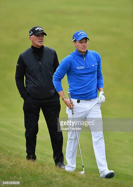 Danny Willett of England looks on next to Pete Cowen during a practice round ahead of the 145th Open Championship at Royal Troon on July 12 2016 in...