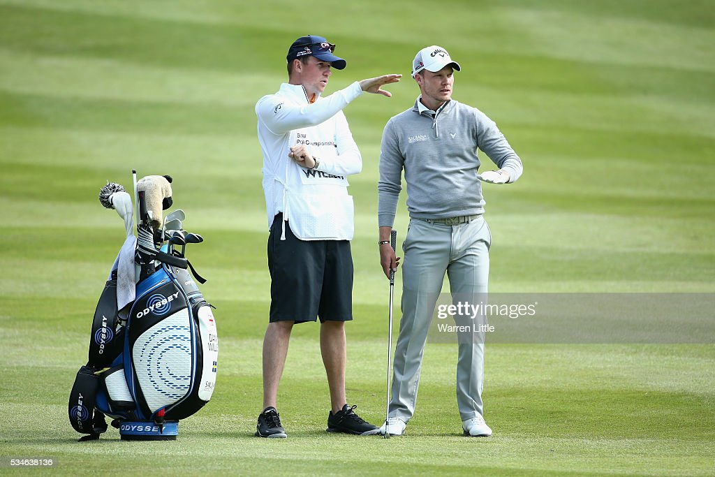<a gi-track='captionPersonalityLinkClicked' href=/galleries/search?phrase=Danny+Willett&family=editorial&specificpeople=4488861 ng-click='$event.stopPropagation()'>Danny Willett</a> of England looks on with his caddie Jonathan Smart during day two of the BMW PGA Championship at Wentworth on May 27, 2016 in Virginia Water, England.