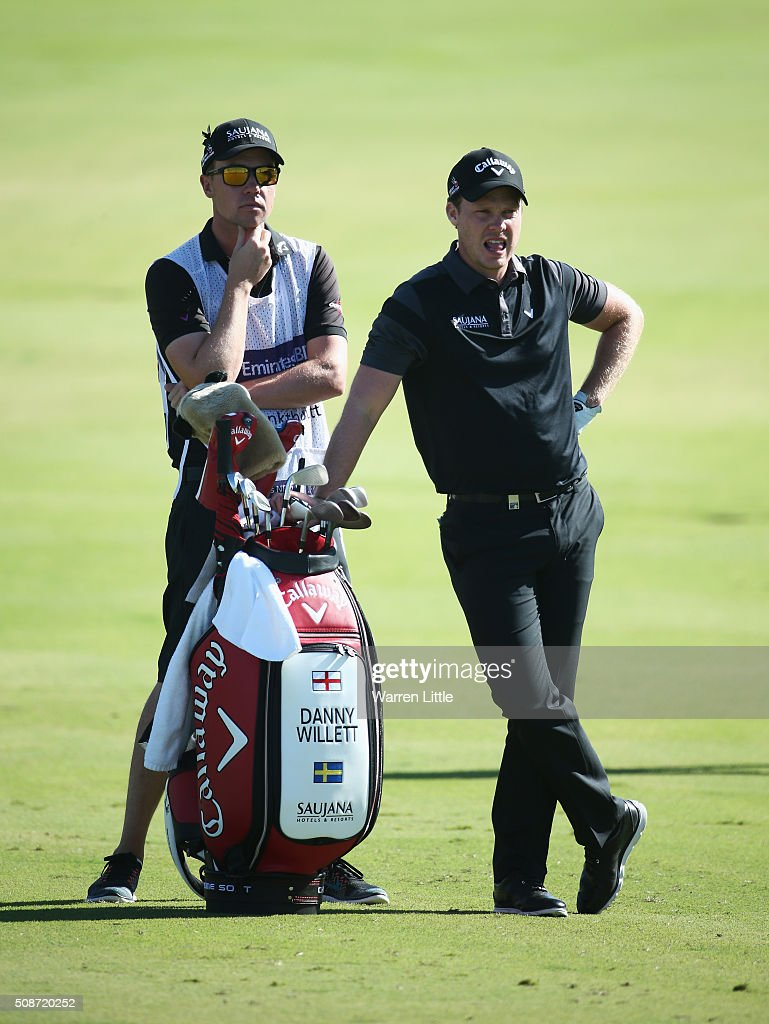 <a gi-track='captionPersonalityLinkClicked' href=/galleries/search?phrase=Danny+Willett&family=editorial&specificpeople=4488861 ng-click='$event.stopPropagation()'>Danny Willett</a> of England looks on with his caddie Jonathan Smart on the 12th hole during the third round of the Omega Dubai Desert Classic at the Emirates Golf Club on February 6, 2016 in Dubai, United Arab Emirates.