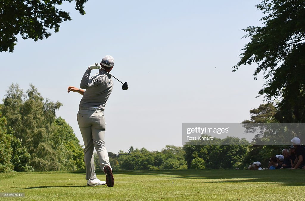 <a gi-track='captionPersonalityLinkClicked' href=/galleries/search?phrase=Danny+Willett&family=editorial&specificpeople=4488861 ng-click='$event.stopPropagation()'>Danny Willett</a> of England loses grip as he tees off on the 17th hole during day two of the BMW PGA Championship at Wentworth on May 27, 2016 in Virginia Water, England.