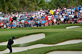 Danny Willett of England out of the bunker on the 16th hole during the third round of the World Golf ChampionshipsCadillac Championship at Trump...