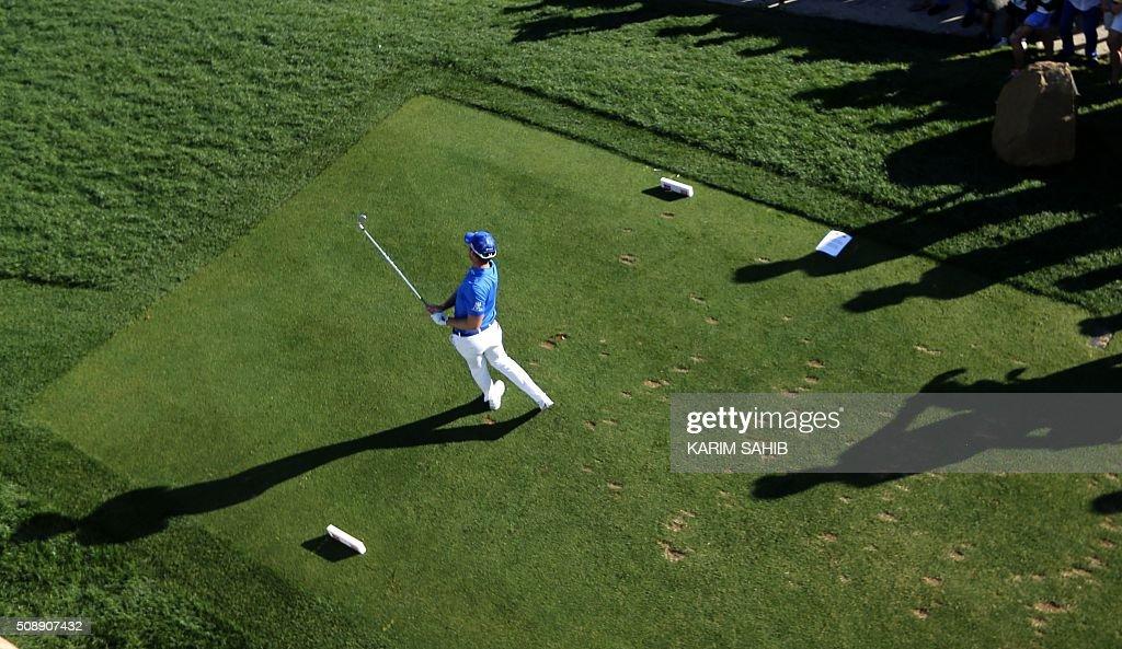 Danny Willett of England plays a shot during the 2016 Dubai Desert Classic at the Emirates Golf Club in Dubai on February 7, 2016. / AFP / KARIM SAHIB