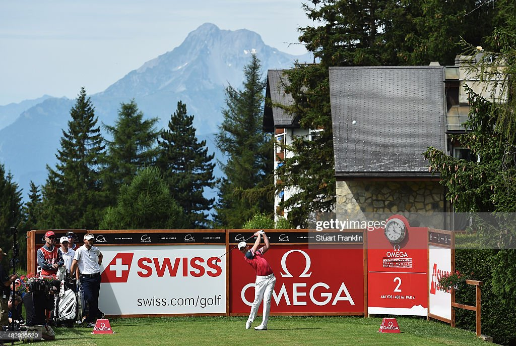 Danny Willett of England plays a shot during the final round of the Omega European Masters at CranssurSierre Golf Club on July 26 2015 in...