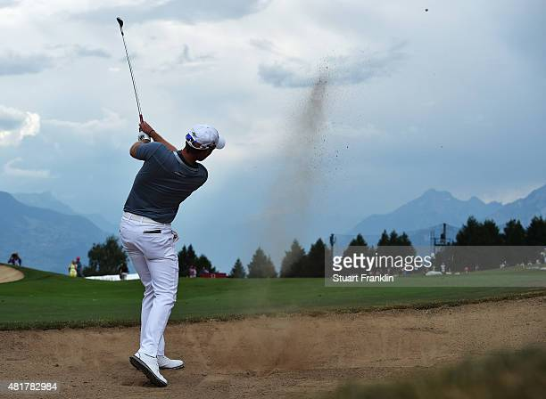 Danny Willett of England plays a shot during the second round of the Omega European Masters at CranssurSierre Golf Club on July 24 2015 in...