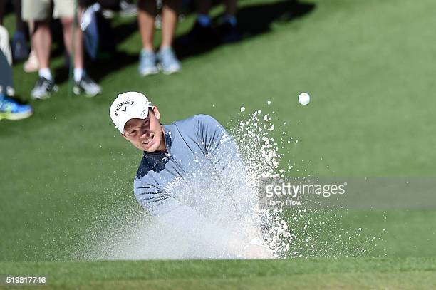Danny Willett of England plays a shot from a bunker on the second hole during the second round of the 2016 Masters Tournament at Augusta National...