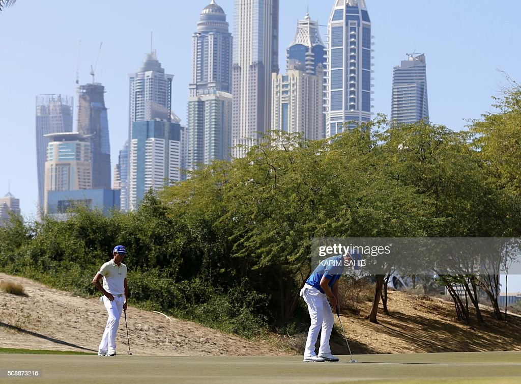 Danny Willett of England plays a shot in the final round of the 2016 Dubai Desert Classic at the Emirates Golf Club in Dubai on February 7, 2016. SAHIB