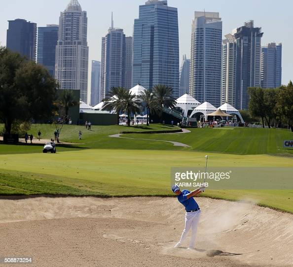 Danny Willett of England plays a shot in the final round of the 2016 Dubai Desert Classic at the Emirates Golf Club in Dubai on February 7 2016 SAHIB