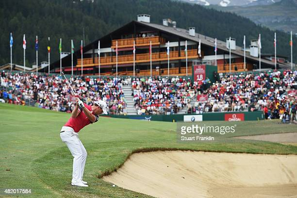 Danny Willett of England plays a shot on the 18th hole during the final round of the Omega European Masters at CranssurSierre Golf Club on July 26...