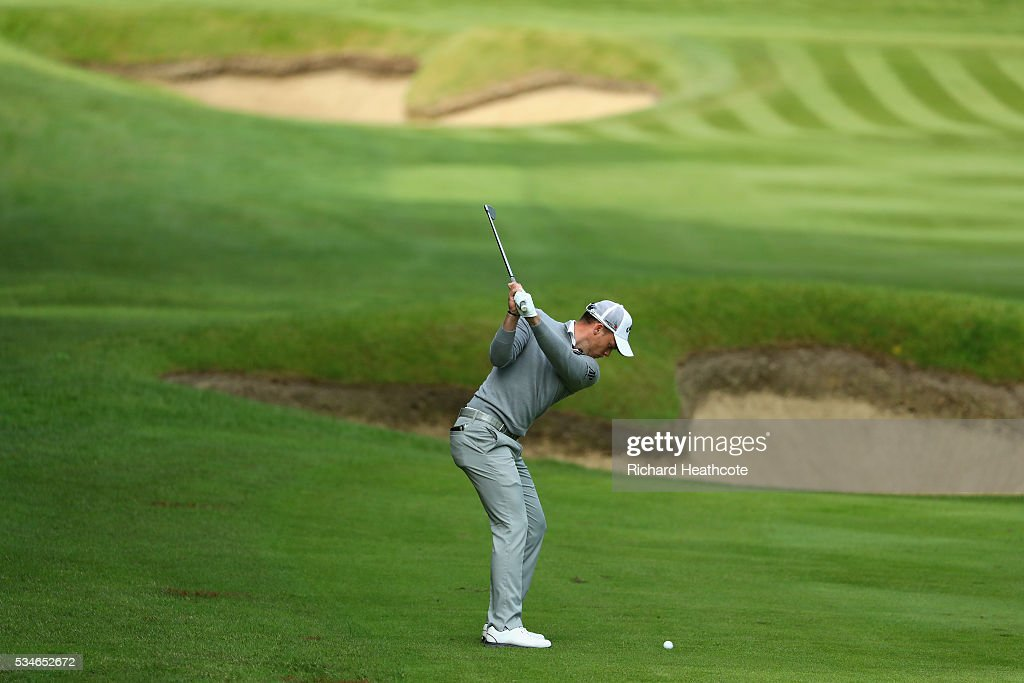 <a gi-track='captionPersonalityLinkClicked' href=/galleries/search?phrase=Danny+Willett&family=editorial&specificpeople=4488861 ng-click='$event.stopPropagation()'>Danny Willett</a> of England plays his 2nd shot on the 3rd hole during day two of the BMW PGA Championship at Wentworth on May 27, 2016 in Virginia Water, England.
