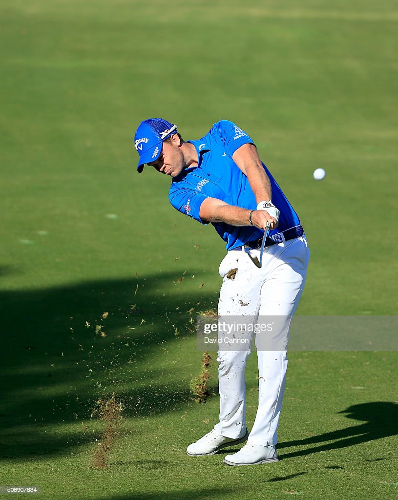 <a gi-track='captionPersonalityLinkClicked' href=/galleries/search?phrase=Danny+Willett&family=editorial&specificpeople=4488861 ng-click='$event.stopPropagation()'>Danny Willett</a> of England plays his second shot at the par 4, 14th hole during the final round of the 2016 Omega Dubai Desert Classic on the Majlis Course at the Emirates Golf Club on February 7, 2016 in Dubai, United Arab Emirates.