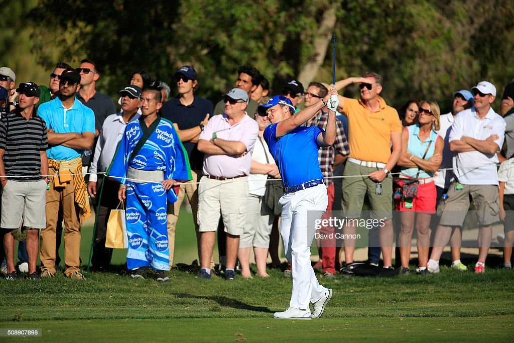 <a gi-track='captionPersonalityLinkClicked' href=/galleries/search?phrase=Danny+Willett&family=editorial&specificpeople=4488861 ng-click='$event.stopPropagation()'>Danny Willett</a> of England plays his second shot at the par 4, 16th hole during the final round of the 2016 Omega Dubai Desert Classic on the Majlis Course at the Emirates Golf Club on February 7, 2016 in Dubai, United Arab Emirates.