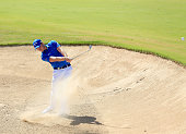 Danny Willett of England plays his second shot at the par 4 first hole during the final round of the 2016 Omega Dubai Desert Classic on the Majlis...