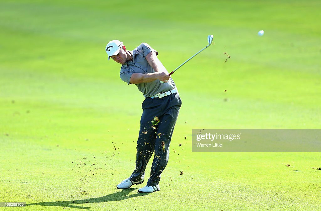 Danny Willett of England plays his second shot into the 14th green during the first round of the Alfred Dunhill Championship at Leopard Creek Country Golf Club on December 13, 2012 in Malelane, South Africa.