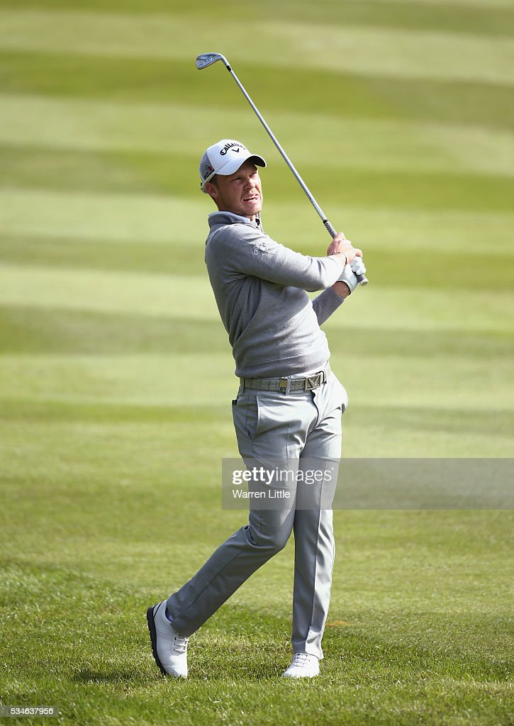 <a gi-track='captionPersonalityLinkClicked' href=/galleries/search?phrase=Danny+Willett&family=editorial&specificpeople=4488861 ng-click='$event.stopPropagation()'>Danny Willett</a> of England plays his second shot on the 4th hole during day two of the BMW PGA Championship at Wentworth on May 27, 2016 in Virginia Water, England.