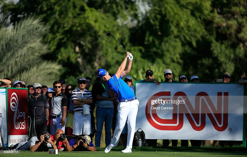 <a gi-track='captionPersonalityLinkClicked' href=/galleries/search?phrase=Danny+Willett&family=editorial&specificpeople=4488861 ng-click='$event.stopPropagation()'>Danny Willett</a> of England plays his tee shot at the par 4, 14th hole during the final round of the 2016 Omega Dubai Desert Classic on the Majlis Course at the Emirates Golf Club on February 7, 2016 in Dubai, United Arab Emirates.