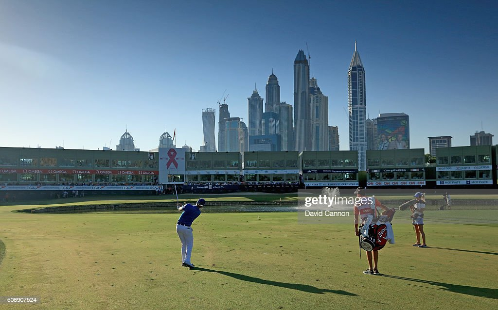Danny Willett of England plays his third shot at the par 5, 18th hole during the final round of the 2016 Omega Dubai Desert Classic on the Majlis Course at the Emirates Golf Club on February 7, 2016 in Dubai, United Arab Emirates.