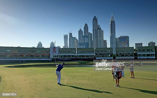 Danny Willett of England plays his third shot at the par 5 18th hole during the final round of the 2016 Omega Dubai Desert Classic on the Majlis...
