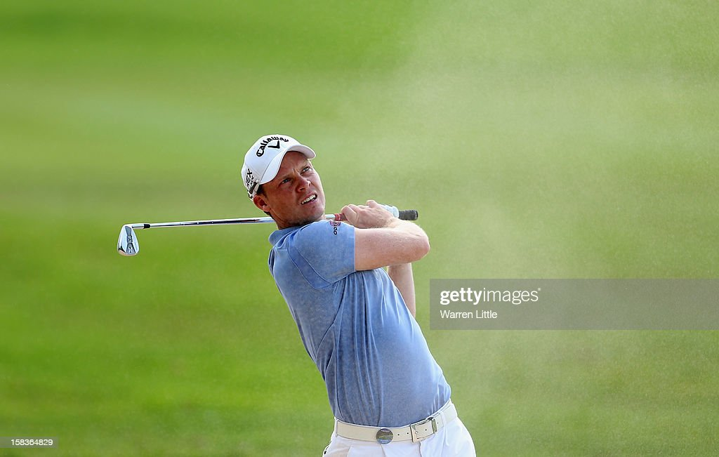 Danny Willett of England plays out of the 13th fairway bunker during the second round of the Alfred Dunhill Championship at Leopard Creek Country Golf Club on December 14, 2012 in Malelane, South Africa.