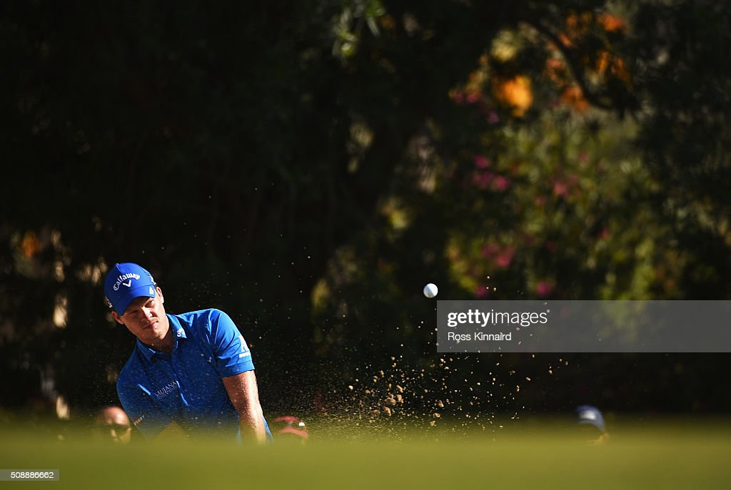 <a gi-track='captionPersonalityLinkClicked' href=/galleries/search?phrase=Danny+Willett&family=editorial&specificpeople=4488861 ng-click='$event.stopPropagation()'>Danny Willett</a> of England plays out of the bunker on the 11th hole during the final round of the Omega Dubai Desert Classic at the Emirates Golf Club on February 7, 2016 in Dubai, United Arab Emirates.
