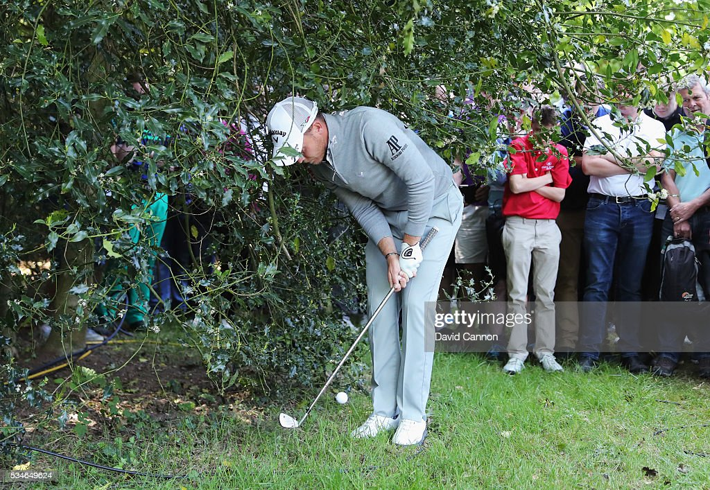 <a gi-track='captionPersonalityLinkClicked' href=/galleries/search?phrase=Danny+Willett&family=editorial&specificpeople=4488861 ng-click='$event.stopPropagation()'>Danny Willett</a> of England plays out of trouble on the 17th hole during day two of the BMW PGA Championship at Wentworth on May 27, 2016 in Virginia Water, England.