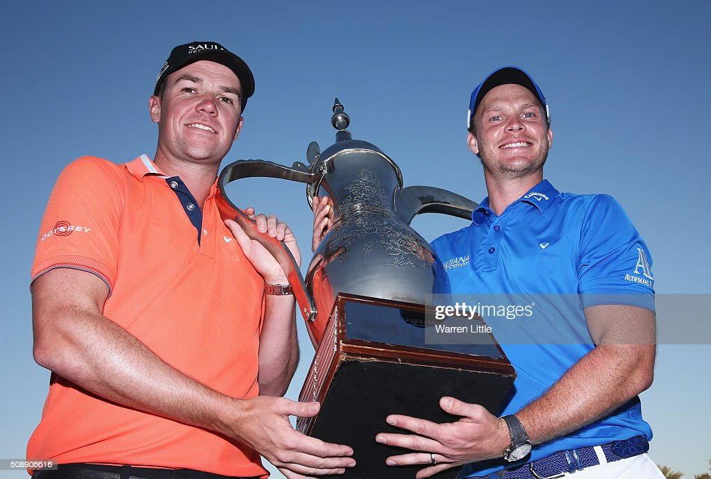 <a gi-track='captionPersonalityLinkClicked' href=/galleries/search?phrase=Danny+Willett&family=editorial&specificpeople=4488861 ng-click='$event.stopPropagation()'>Danny Willett</a> (R) of England poses with caddie Jonathan Smart and the trophy after his victory during the final round of the Omega Dubai Desert Classic at the Emirates Golf Club on February 7, 2016 in Dubai, United Arab Emirates.