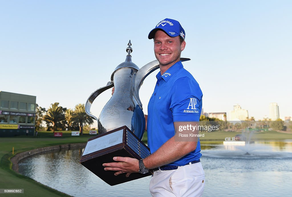 <a gi-track='captionPersonalityLinkClicked' href=/galleries/search?phrase=Danny+Willett&family=editorial&specificpeople=4488861 ng-click='$event.stopPropagation()'>Danny Willett</a> of England poses with the trophy after his victory in the Omega Dubai Desert Classic at the Emirates Golf Club on February 7, 2016 in Dubai, United Arab Emirates.