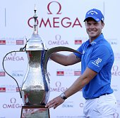 Danny Willett of England poses with the trophy after his victory in the 2016 Dubai Desert Classic at the Emirates Golf Club in Dubai on February 7...
