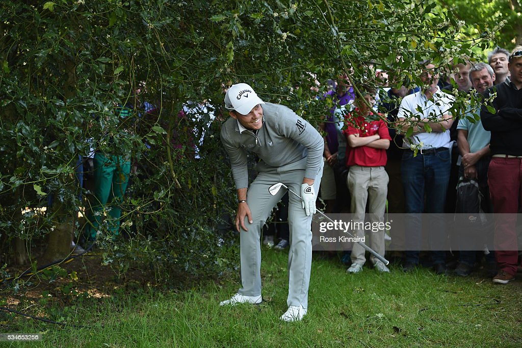 <a gi-track='captionPersonalityLinkClicked' href=/galleries/search?phrase=Danny+Willett&family=editorial&specificpeople=4488861 ng-click='$event.stopPropagation()'>Danny Willett</a> of England prepares to hit his 2nd shot on the 17th hole during day two of the BMW PGA Championship at Wentworth on May 27, 2016 in Virginia Water, England.
