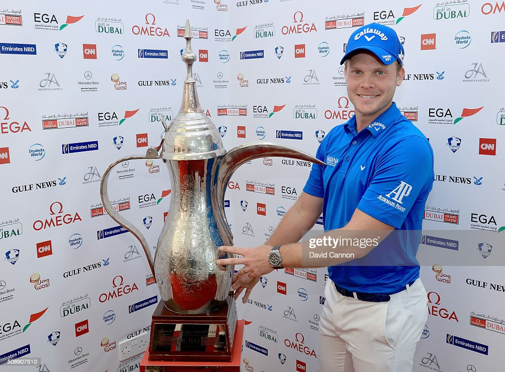 <a gi-track='captionPersonalityLinkClicked' href=/galleries/search?phrase=Danny+Willett&family=editorial&specificpeople=4488861 ng-click='$event.stopPropagation()'>Danny Willett</a> of England proudly holds the trophy after his one shot victory in the final round of the 2016 Omega Dubai Desert Classic on the Majlis Course at the Emirates Golf Club on February 7, 2016 in Dubai, United Arab Emirates.
