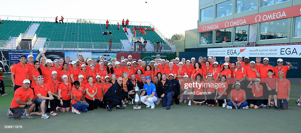 <a gi-track='captionPersonalityLinkClicked' href=/galleries/search?phrase=Danny+Willett&family=editorial&specificpeople=4488861 ng-click='$event.stopPropagation()'>Danny Willett</a> of England proudly holds the trophy in amongst a group of course marshalls after his one shot victory in the final round of the 2016 Omega Dubai Desert Classic on the Majlis Course at the Emirates Golf Club on February 7, 2016 in Dubai, United Arab Emirates.