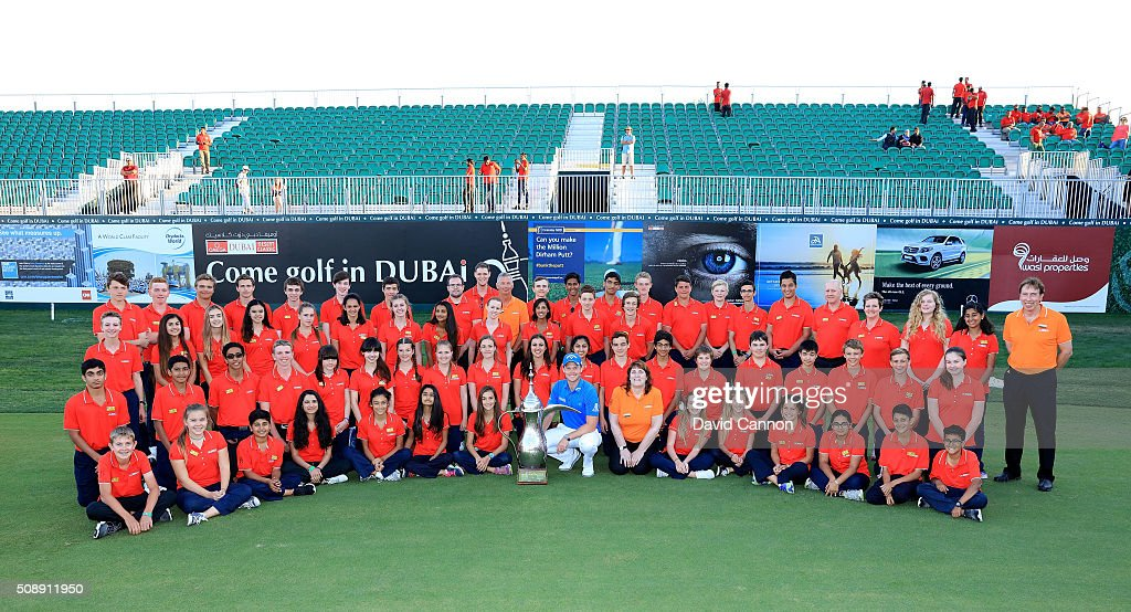 <a gi-track='captionPersonalityLinkClicked' href=/galleries/search?phrase=Danny+Willett&family=editorial&specificpeople=4488861 ng-click='$event.stopPropagation()'>Danny Willett</a> of England proudly holds the trophy in amongst children from Dubai College who operated the scoreboards during the event after his one shot victory in the final round of the 2016 Omega Dubai Desert Classic on the Majlis Course at the Emirates Golf Club on February 7, 2016 in Dubai, United Arab Emirates.