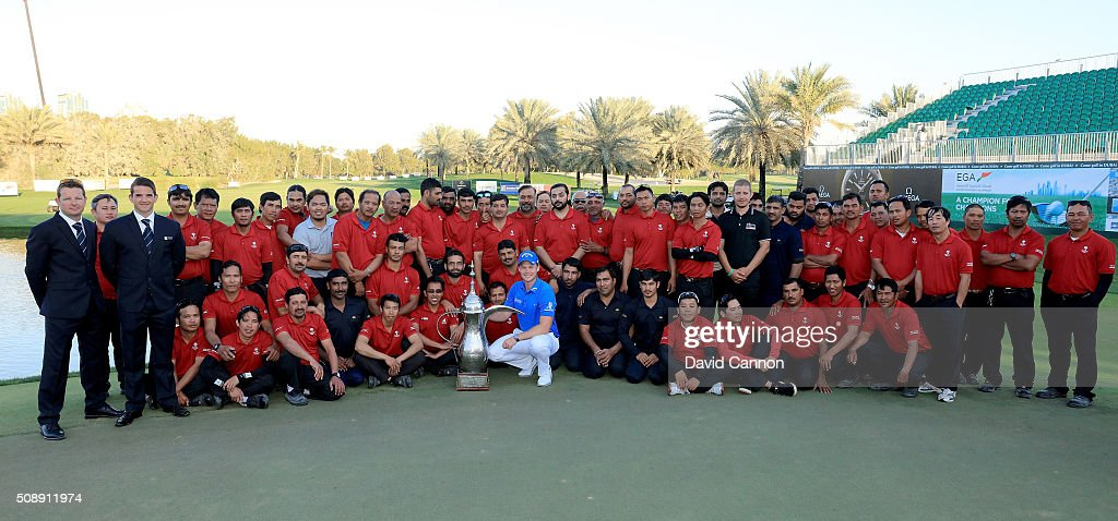 <a gi-track='captionPersonalityLinkClicked' href=/galleries/search?phrase=Danny+Willett&family=editorial&specificpeople=4488861 ng-click='$event.stopPropagation()'>Danny Willett</a> of England proudly holds the trophy in amongst members of the Emirates Golf Club greenstaff during the event after his one shot victory in the final round of the 2016 Omega Dubai Desert Classic on the Majlis Course at the Emirates Golf Club on February 7, 2016 in Dubai, United Arab Emirates.
