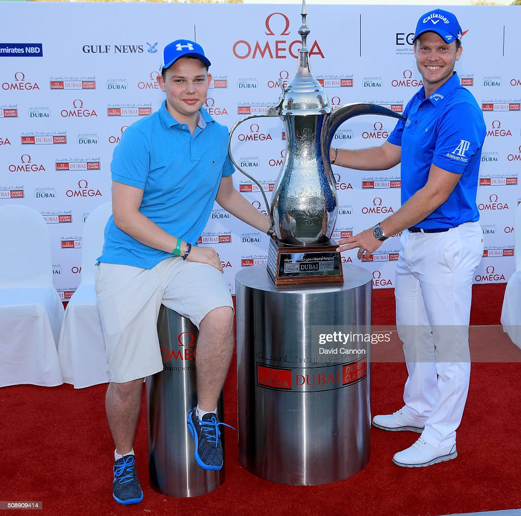 <a gi-track='captionPersonalityLinkClicked' href=/galleries/search?phrase=Danny+Willett&family=editorial&specificpeople=4488861 ng-click='$event.stopPropagation()'>Danny Willett</a> of England proudly holds the trophy with his younger brother after his one shot victory in the final round of the 2016 Omega Dubai Desert Classic on the Majlis Course at the Emirates Golf Club on February 7, 2016 in Dubai, United Arab Emirates.