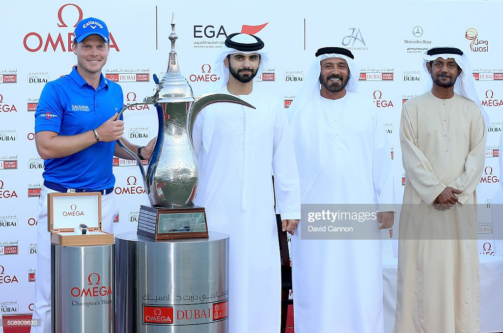 <a gi-track='captionPersonalityLinkClicked' href=/galleries/search?phrase=Danny+Willett&family=editorial&specificpeople=4488861 ng-click='$event.stopPropagation()'>Danny Willett</a> of England proudly is presented with the trophy by Sheikh Mansour Bin Mohammed Bin Rashid Al Maktoum also in the picture are Mohamed Juma Buamaim The vice-chairman and CEO of Golf in Dubai, and Sheikh Fahim Bin Sultan Al Qasimi the Chairman of the Emirates Golf Federation after his one shot victory in the final round of the 2016 Omega Dubai Desert Classic on the Majlis Course at the Emirates Golf Club on February 7, 2016 in Dubai, United Arab Emirates.
