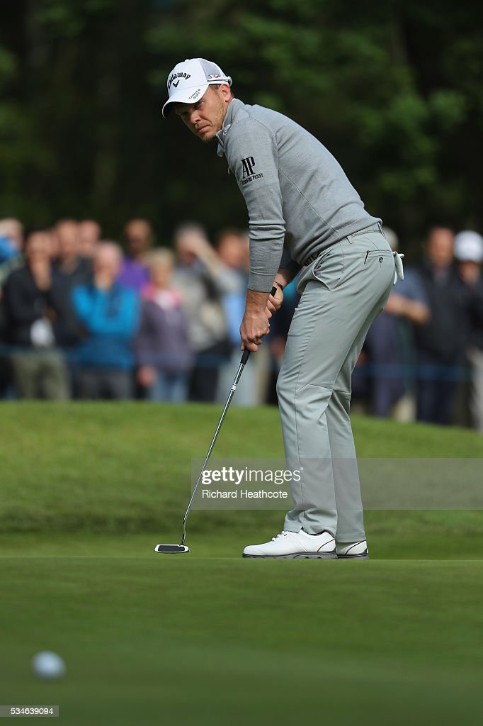 Danny Willett of England putts on the 4th hole during day two of the BMW PGA Championship at Wentworth on May 27, 2016 in Virginia Water, England.