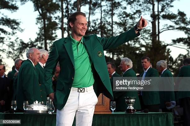 Danny Willett of England reacts after being presented with the green jacket for winning the final round of the 2016 Masters Tournament at Augusta...