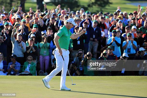 Danny Willett of England reacts after finishing on the 18th green during the final round of the 2016 Masters Tournament at Augusta National Golf Club...
