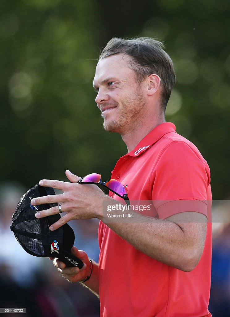 <a gi-track='captionPersonalityLinkClicked' href=/galleries/search?phrase=Danny+Willett&family=editorial&specificpeople=4488861 ng-click='$event.stopPropagation()'>Danny Willett</a> of England reacts on the 18th green during day one of the BMW PGA Championship at Wentworth on May 26, 2016 in Virginia Water, England.