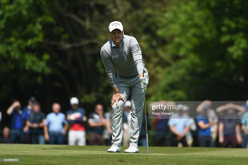 <a gi-track='captionPersonalityLinkClicked' href=/galleries/search?phrase=Danny+Willett&family=editorial&specificpeople=4488861 ng-click='$event.stopPropagation()'>Danny Willett</a> of England reacts on the 18th hole during day two of the BMW PGA Championship at Wentworth on May 27, 2016 in Virginia Water, England.